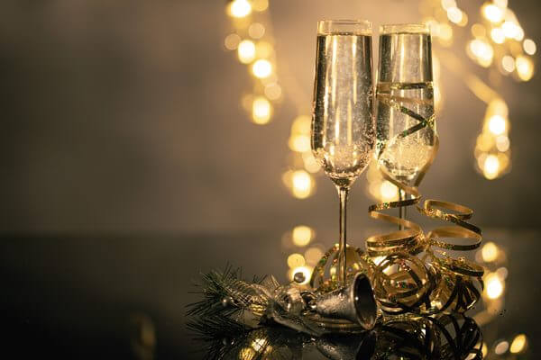 Two champagne glasses filled